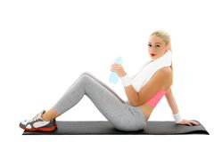 Woman holding bottle with water over white Stock Photography