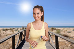 Woman Holding Bottle of Water Stock Image
