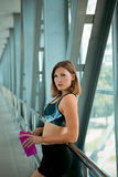 Woman holding bottle of water, taking a break from exercise. Royalty Free Stock Image
