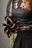 Woman holding bouquet of black calla flowers (Zantedeschia) Royalty Free Stock Images