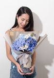 Woman holding bouquet flower. Asian young woman Stock Photo