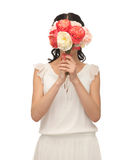 Woman holding bouquet of flowers over her face Royalty Free Stock Image