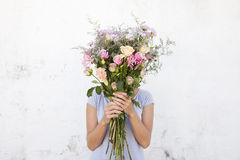 Woman holding bouquet of flowers Royalty Free Stock Photos