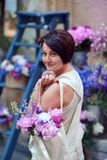 Woman holding a bouquet of peonies royalty free stock photos