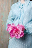 Woman holding bouquet of pink peonies Stock Photography
