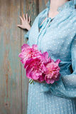 Woman holding bouquet of pink peonies Royalty Free Stock Photos