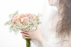 Woman holding bouquet of pink roses Royalty Free Stock Images