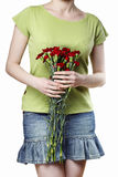 Woman holding bouquet of red carnations Royalty Free Stock Images