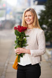 Woman holding a bouquet of red roses Royalty Free Stock Photos
