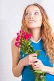 Woman holding bouquet of roses Stock Image