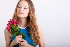 Woman holding bouquet of roses Royalty Free Stock Images