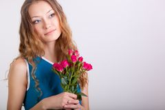 Woman holding bouquet of roses Royalty Free Stock Photo