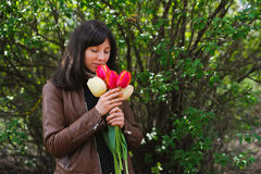 Woman holding bouquet and smell flower aroma Royalty Free Stock Images