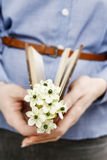 Woman holding bouquet of tiny white flowers (ornithogalum arabic. Um). Spring flowers Stock Images