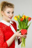 Woman holding tulips and gift royalty free stock image