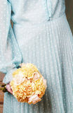 Woman holding bouquet of yellow carnation and pink pastel roses Royalty Free Stock Images