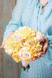 Woman holding bouquet of yellow carnation and pink roses Royalty Free Stock Image