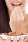 Woman holding a bowl of almonds,focus on bowl stock photos