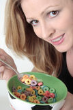 Woman holding bowl of cereal royalty free stock photography