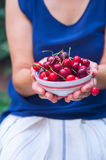 Woman holding bowl of cherries Royalty Free Stock Photography