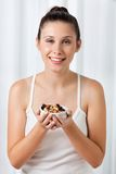 Woman Holding Bowl Of Dry Fruits Stock Image