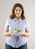 Woman holding bowl of fresh fruit salad Stock Images