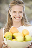 A woman holding a bowl of fruit Royalty Free Stock Photos
