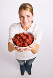 Woman holding bowl of raspberries Royalty Free Stock Photography