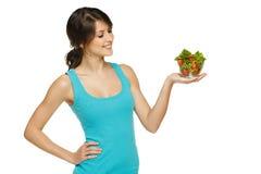 Woman holding bowl with salad Stock Photos