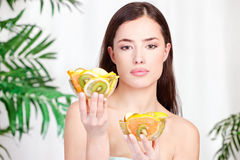 Woman holding bowls full of fruit Stock Photo