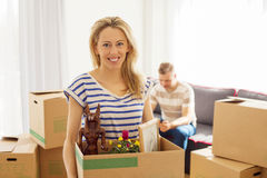 Woman holding box with objects Royalty Free Stock Image