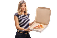 Woman holding a box with a slice of pizza Stock Photography