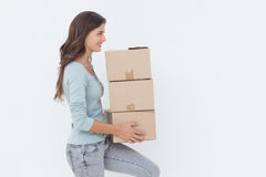 Woman holding boxes because she is moving in a new house Stock Photos