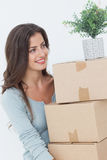 Woman holding boxes because she is moving Royalty Free Stock Photos