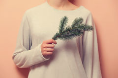 Woman holding a branch Royalty Free Stock Photo