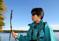 Woman Holding Branch of Zebra Mussels. Woman holding branch covered with zebra mussels. Charleston Lake Provincial Park. Ontario. Canada Stock Images