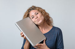 Woman Holding a Brand New Laptop Stock Photo