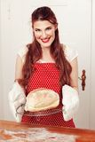 Woman holding a bread Royalty Free Stock Photo