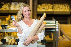Woman holding bread and credit card Royalty Free Stock Images