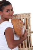 Woman holding bread Royalty Free Stock Photos