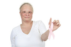 Woman holding a breast cancer logo Stock Photography