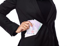 Woman holding a bribery money Royalty Free Stock Image