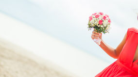 Woman holding a bridal bouquet Stock Image