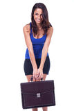 Woman is holding briefcase Stock Photography