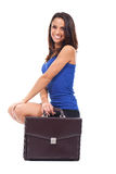 Woman is holding a briefcase Stock Photo