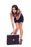 Woman is holding briefcase Royalty Free Stock Images