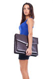 Woman is holding briefcase Royalty Free Stock Image