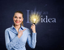 Woman holding bright bulb Royalty Free Stock Photo