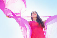 Woman holding bright violet textile Royalty Free Stock Image
