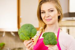 Woman holding broccoli vegetable. Happy young woman holding raw green vegetable broccoli. Natural organic healthy food concept Royalty Free Stock Image